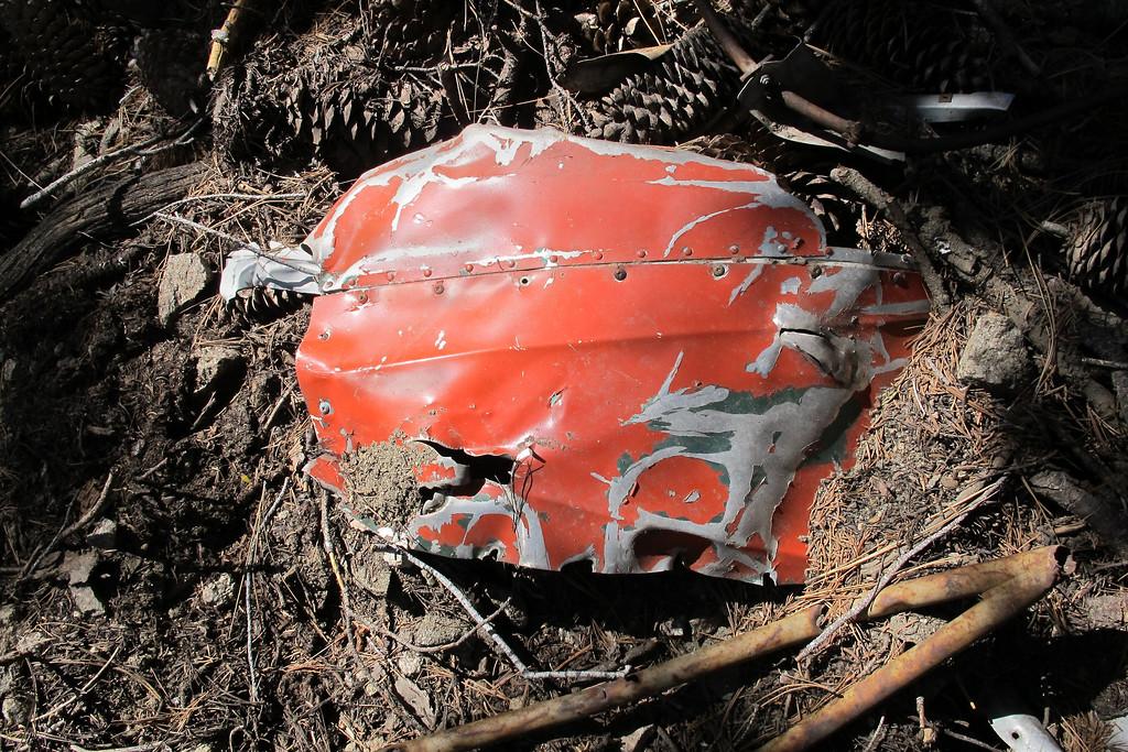 Fuselage skin with red/orange paint.