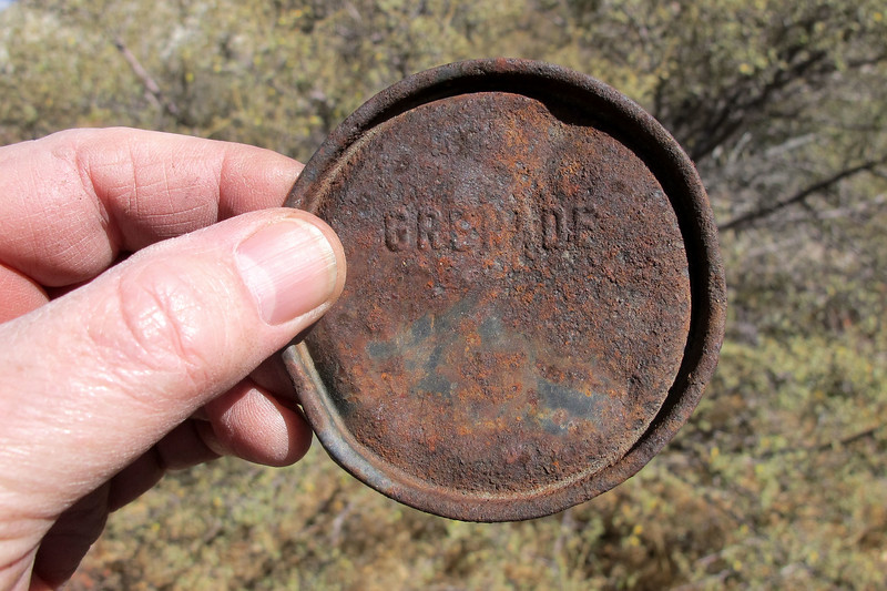 Tom found a couple of these lids near the cans. They maybe from containers for the smoke grenades.
