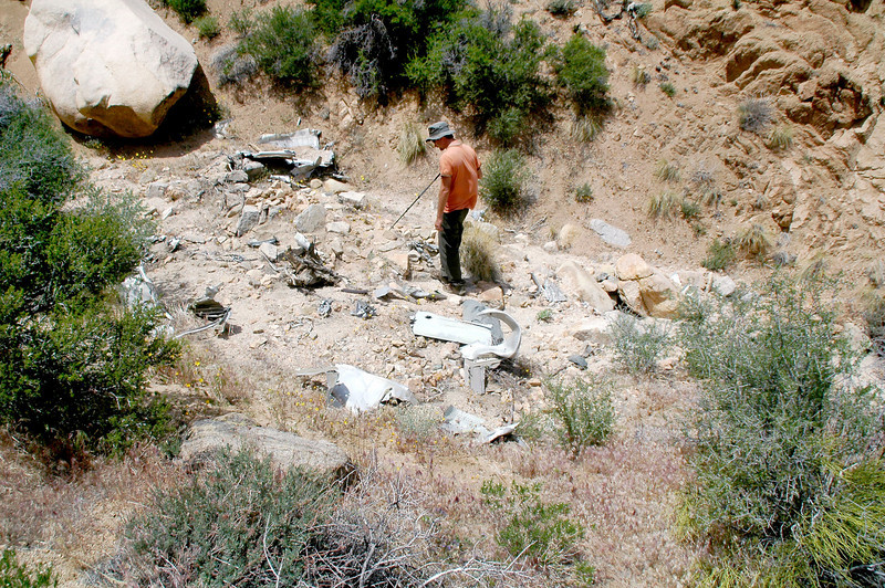 Ryan looking at  some of the wreckage in the canyon.
