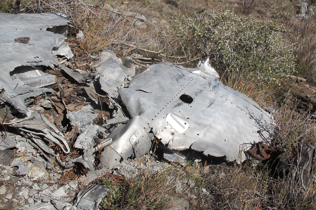 This piece looks like it's from the outer section of the same wing. I think that the fire damage on most if not all of the wreckage was cause by forest fires. The photos I've seen of the crash site shortly after it was found doesn't show any signs burning .