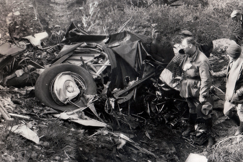 This photo was provided by G. Pat Macha. It shows pilot Dudley Steele and pilot/observer Juanita Burns at the wreckage the day after it was located. Here's the text that was on the back of the photo. <br /> <br />  REFERENCE DEPT. MAR 10 1930 N.E.A.<br /> <br /> WRECKED AIR LINER FOUND AFTER TWO-WEEKS SEARCH<br /> <br /> Object of a frantic two-weeks search by scores of planes and hundreds of mountaineers, the missing tri-motored air liner which dropped from sight in a storm between Kingman, Ariz., and Los Angeles has been found wrecked in an inaccessible spot in the Sierras with its complement of three men, including the noted pilot Jim Doles, dead. Mrs. Juanita Eloise Burns, 25-year-old Texas woman flyer, located the wrecked plane by reasoning out the actions Pilot Doles would probably have taken and searching for the where she thought it would be, after scores of men flyers had totally failed to locate the ship. <br /> <br /> Memo: Had considerable expense on this, since we all had to chip in and finance the expedition into the mountains.