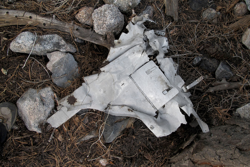 Other side of the same piece. Looking at photos of Beech 95s, found out this piece is from one of the engine nacelles.