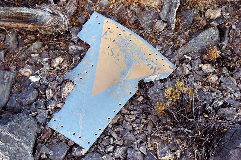 "Piece  of the fuselage marked ""EJECTION SEAT""."