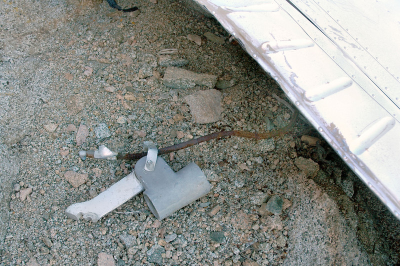 This piece from one of the main landing gears was still attached to the right wing by the brake hose.