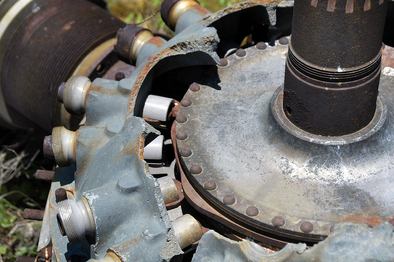 Cam and lifters can be seen inside the broken crankcase.