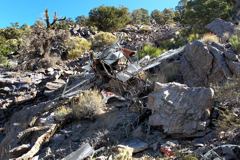 Nearby was the remains of the Tri-Pacer. I was able to match up the rocks on the right with the old crash site photo. The plane has fallen over onto its back