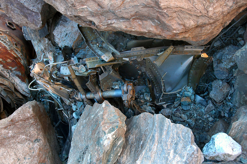 These pieces are under the rocks by the engine.