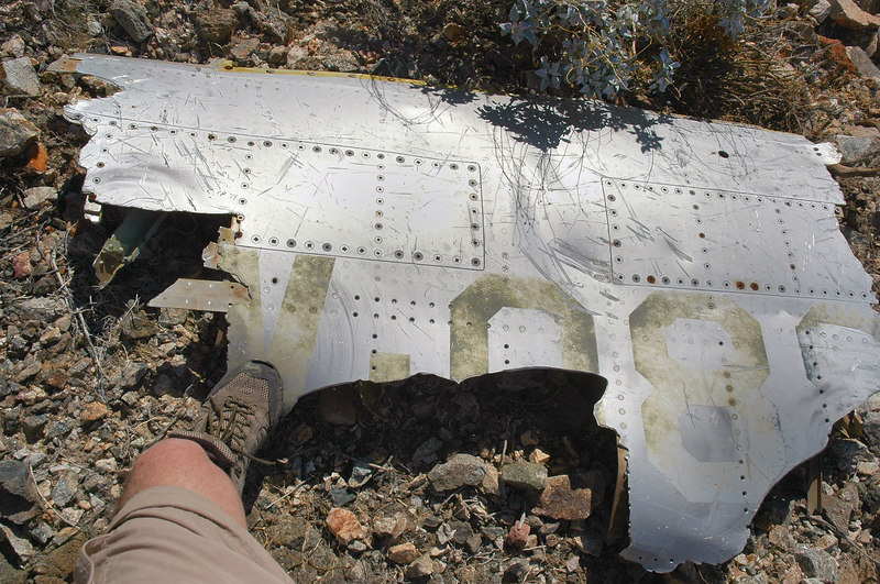 A fuselage section with part of the aircraft's ID.