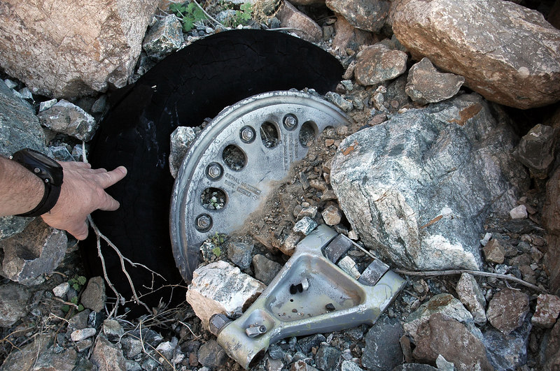 One of the main wheels half buried was also near the engine.