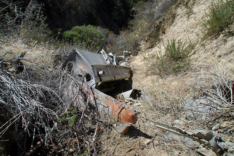Looking back down on the tank and the piece from the fuselage that still has some of the orange paint that the Hemet Valley Flying Service TBMs were painted.