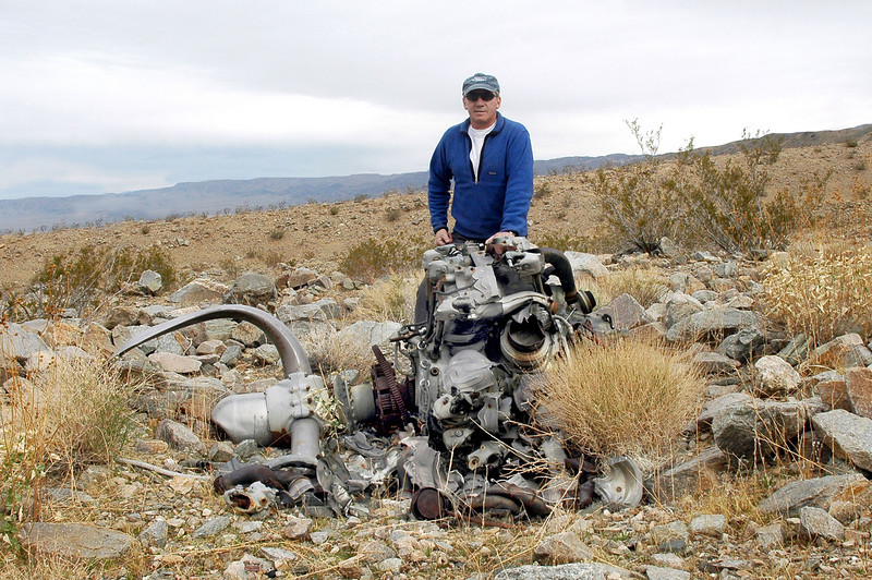 Photo of me with the engine before hiking on to look for the crash site of #02649 which should be somewhere nearby.