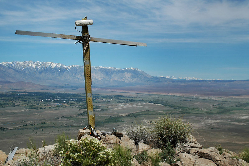 The cross on the peak with the Bishop Airport in the Owens Valley below. The flight didn't get very far. Couldn't figure out the significance of the paint roller on top.