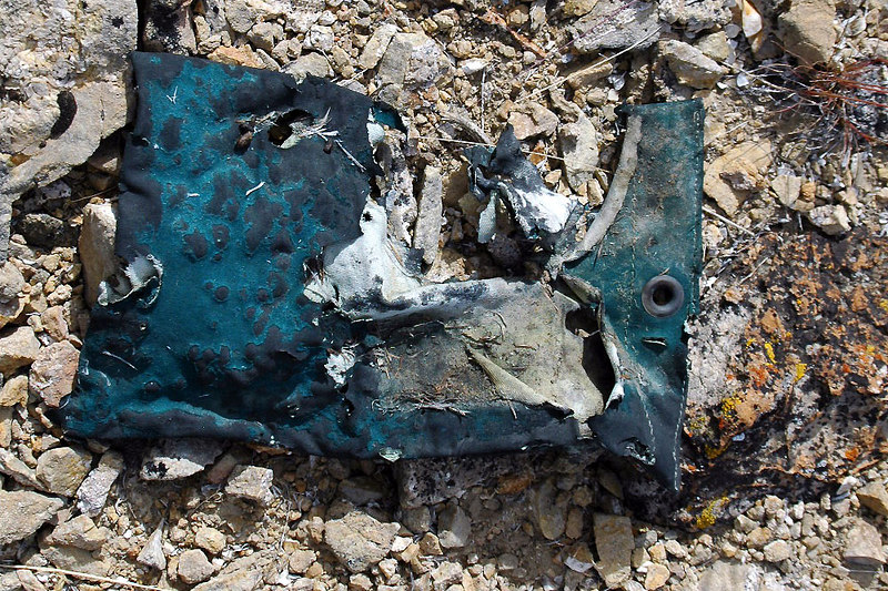 This rubberized bag showed signs from the fire. After the crash, the wreckage burned all night. The plane was carrying 575 gallons of aviation gasoline.