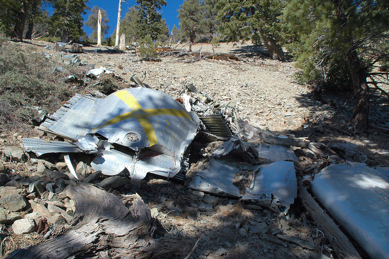 This part is laying next to the piece of wing. The yellow X marks it as a known crash site so people don't report it as a downed plane.