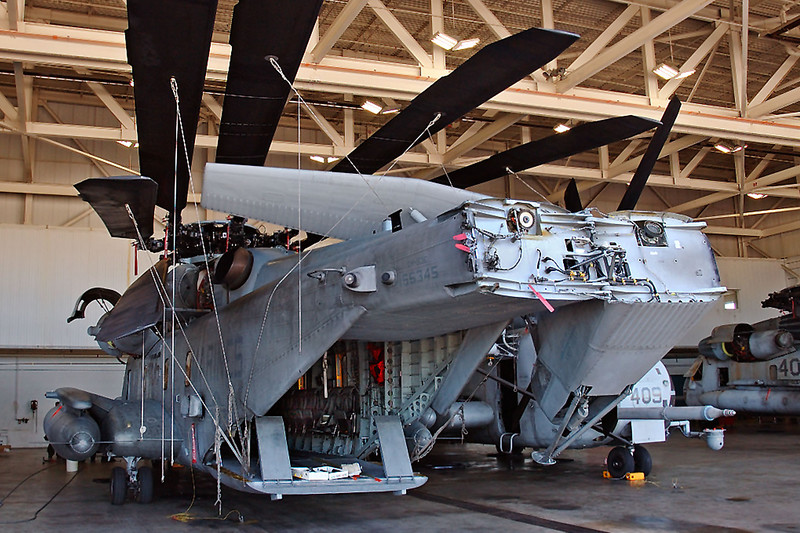 Photo of a CH-53E with it's tailboom and rotors folded.