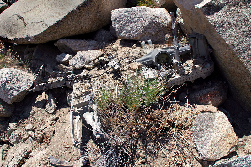 Found partially buried wreckage in a few places. This is a section of the fuselage with part of the landing gear.