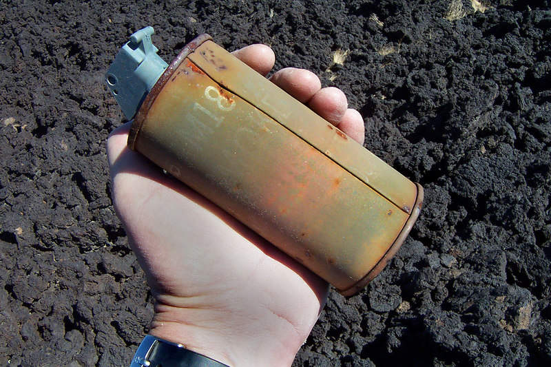 A couple hundred feet from the crash site I came upon a smoke grenade. The lever was missing from it, but it didn't go off. It's still was filled.
