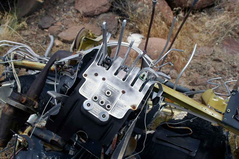 Closer view of the throttle quadrant with the throttle, prop control and mixture levers.