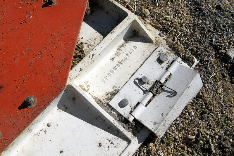 One of the two spring loaded hinges, both are broken off.