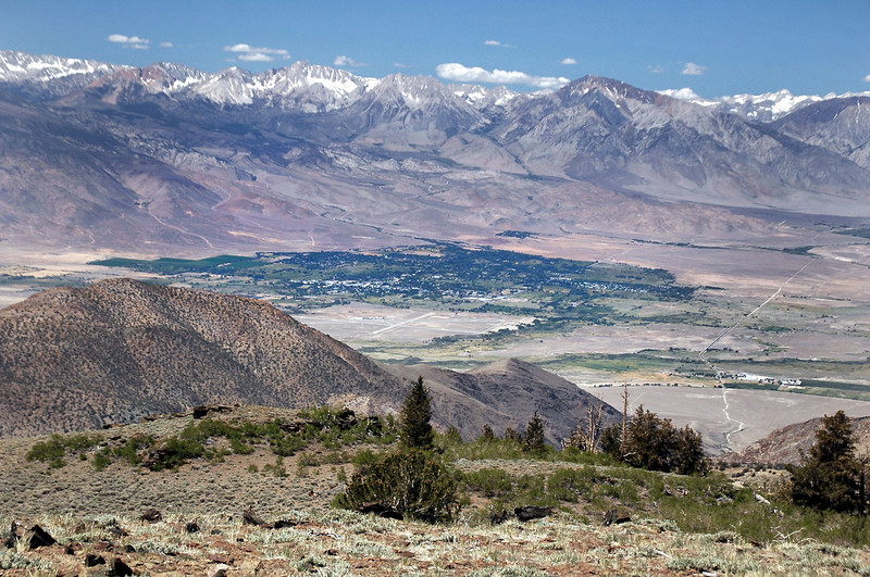 View of Bishop and a section of the Sierra to the west from the top of the road at 10,500 feet. The clearing at the center of the photo is the Bishop Airport 6,400 feet below.