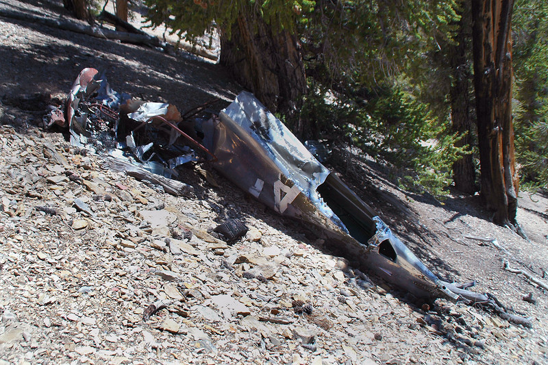 The rear section of the fuselage was the lowest piece of wreckage on the slope. The A and part of the R is visible on this side.