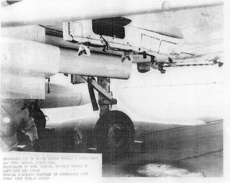 The damage caused to the pylon when the left drop tank separated from the aircraft.