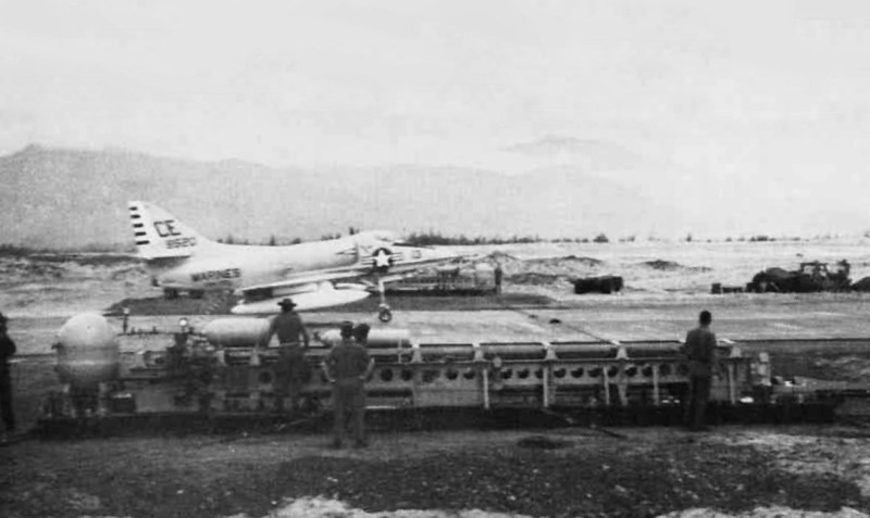Photo of the A-4C BuNo 148520 taken in 1965 landing on a runway built of SATS panels by Seabees of MCB-10 at Chu Lai, Vietnam. At the time, it was flying with the VMA-225. <br /> <br /> Naval Aviation News Photo.
