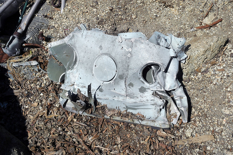 This piece was next to the engine, it had three covers on it. No idea where it's from.