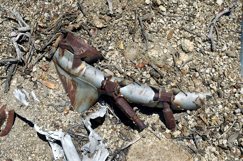 One of the engine mounts. Some of the wreckage is being buried by the steep loose slope.
