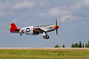 This P-51 Mustang - painted in the Tuskegee paint scheme takes off in preperation for a great show.