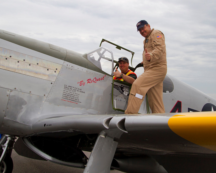 A woman passing by saw me talking to the pilot and offered to take my photo so up I went to sit in the pilots seat of this P-51 Mustang.