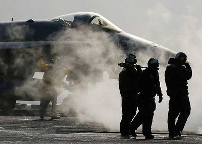 "An F/A-18E Super Hornet assigned to the ""Fighting Vigilantes"" of Strike Fighter Squadron One Five One (VFA-151) prepares to launch from the flight deck of the Nimitz-class aircraft carrier USS Abraham Lincoln (CVN 72)."