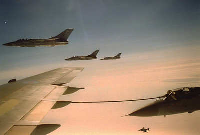 A Tornado takes on fuel from the starboard wing hose whilst three more Tornados fly in formation and a Phantom turns in to join from below.