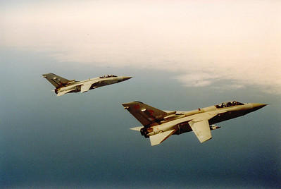 Two Tornados in formation off the port wing.