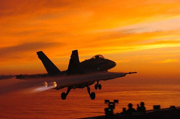 """An F/A-18C Hornet, assigned to the """"Death Rattlers"""" of Marine Fighter Attack Squadron Three Two Three (VMFA-323) launches from the flight deck aboard the Nimitz-class aircraft carrier USS John C. Stennis (CVN 74)."""