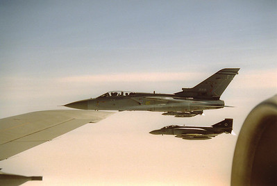 A Tornado and two Phantoms off the starboard wing of the VC10.