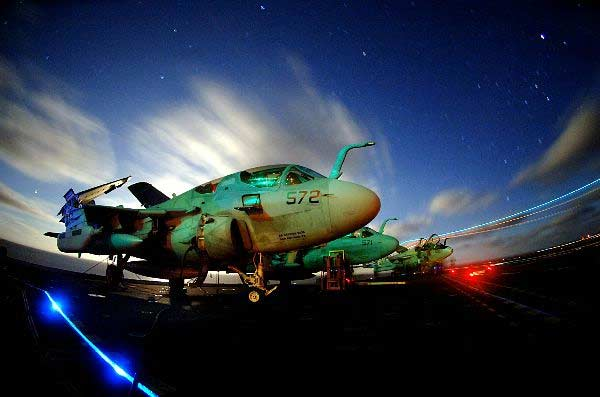 """EA-6B Prowlers assigned to the """"Vikings"""" of Tactical Electronic Warfare Squadron One Two Nine (VAQ-129) sit chained to the flight deck aboard the Nimitz-class aircraft carrier USS John C. Stennis (CVN 74)."""