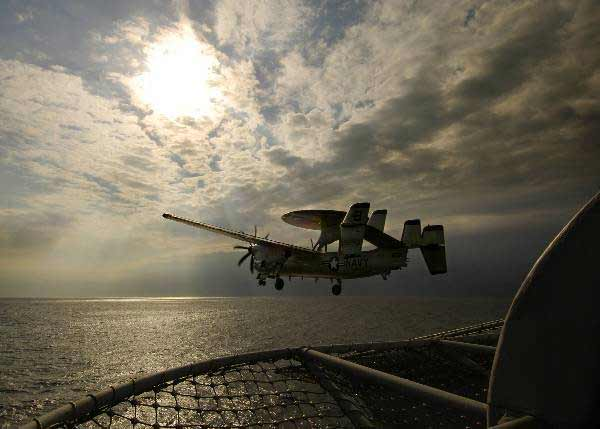 "An E-2C Hawkeye assigned to the ""Screwtops"" of Carrier Airborne Early Warning Squadron One Two Three (VAW-123), launches from the flight deck aboard the nuclear-powered aircraft carrier USS Enterprise (CVN 65)."