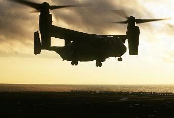 Almost futuristic in its design, the CV-22 looks like a helicopter on the ground with two sets of propeller rotors on each wing tip. Once airborne, the rotors tilt forward so the aircraft resembles a dragon fly with turboprops.