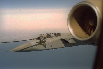 With land visible in the distance below, an F3 takes on fuel off the starboard side.