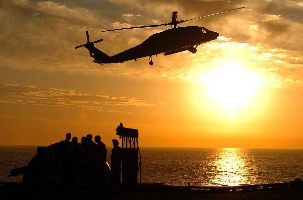 """A SH-60 Seahawk from """"Eightballers"""" of Helicopter Antisubmarine Squadron Eight (HS-8) prepare for landing on the flight deck of the Nimitz-class aircraft carrier USS John C. Stennis (CVN 74)."""