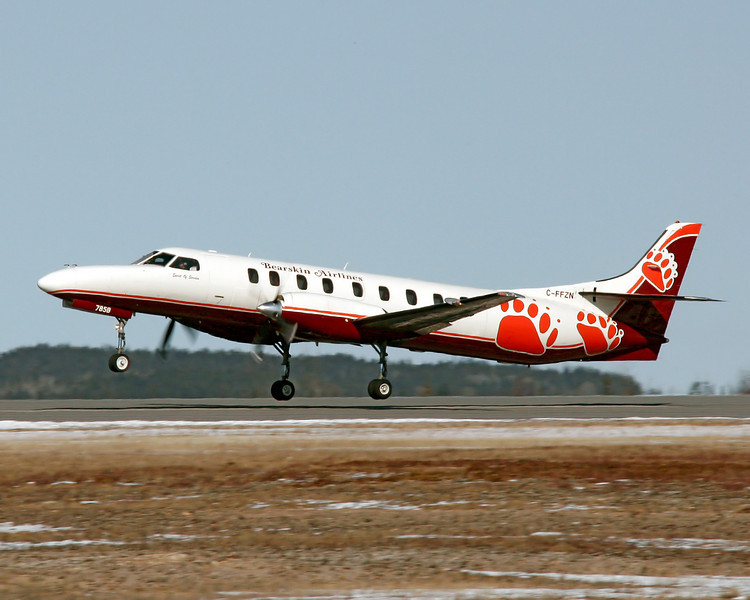 Bearskin Airlines Metro C-FFZN takes off from runway 29 in Dryden with a new paint job.