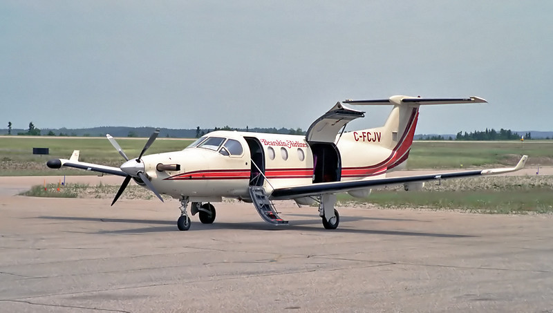 """A Bearsking Airlines Pilatus PC-12. Bearskin has since sold all of their PC-12's.  The wide door was used as the cargo door. It is also used as a entry/exit door for patients on a gurny. Negative scanned with a Nikon Coolscan IV ED.  This PC-12 is now owned by <a href=""""http://www.djkennedy.com/gallery/2032773#221000468"""">NAC</a>."""