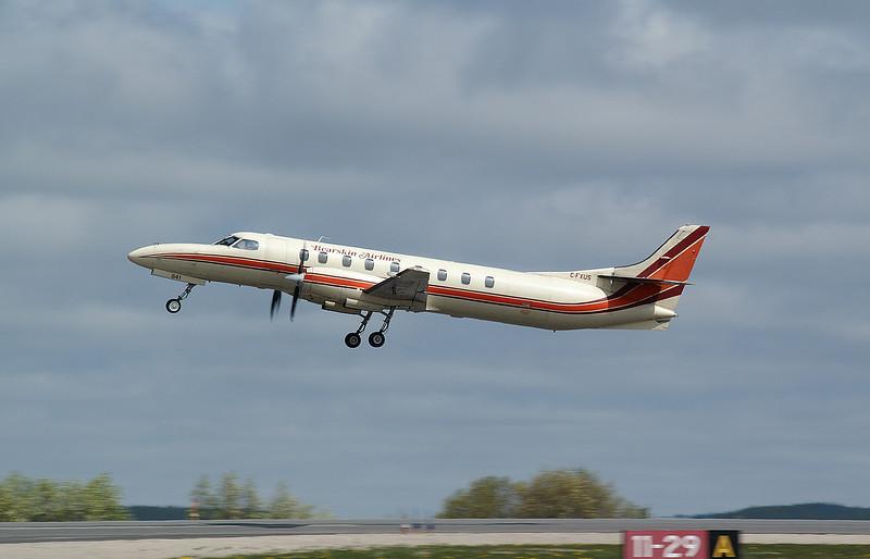 Bearskin Airlines takes off on runway 29 in one of their many Metros.