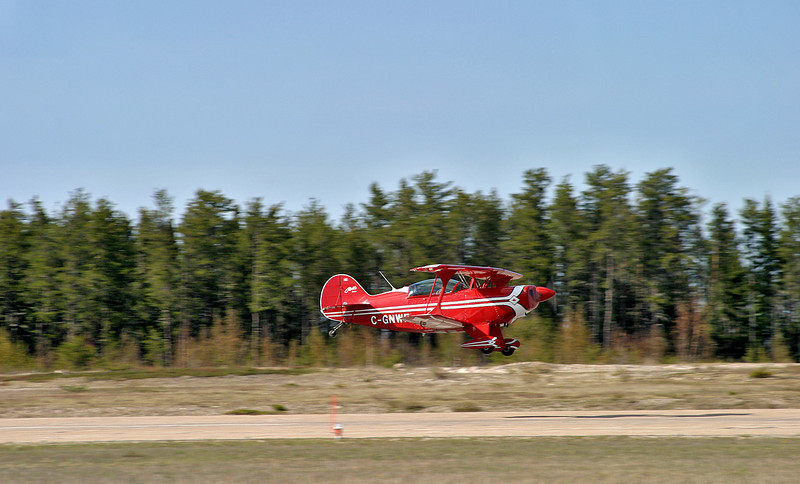 A Pitts Special S-2B just after take off on runway 11 at the Dryden Airport.