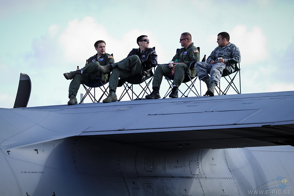 Relaxing on the wing of a C-130J-30 Hercules