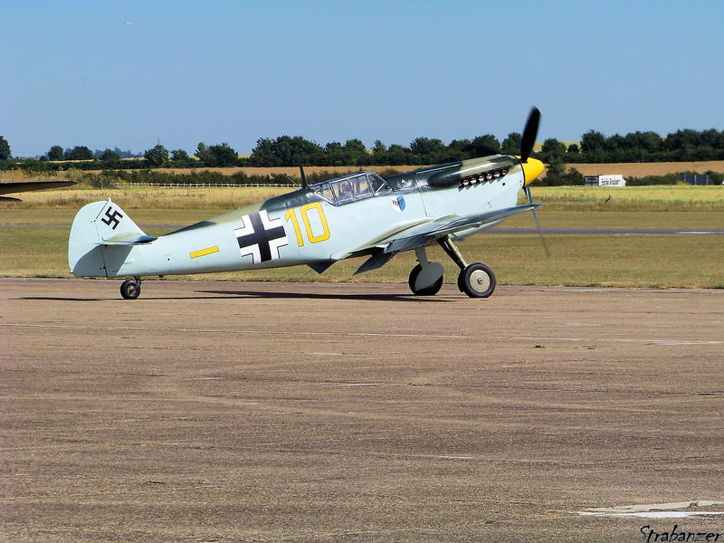 "Hispano HA-112 MIL (Buchon) (RR Merlin Bf109)<br /> G_AWHK<br /> Pianted in the weathered desert color-scheme of Messerschmitt <br /> Bf109 E-7 ""Yellow 10""<br /> <br /> Duxford, UK, 07/10/2015<br /> This work is licensed under a Creative Commons Attribution-<br /> NonCommercial 4.0 International License"