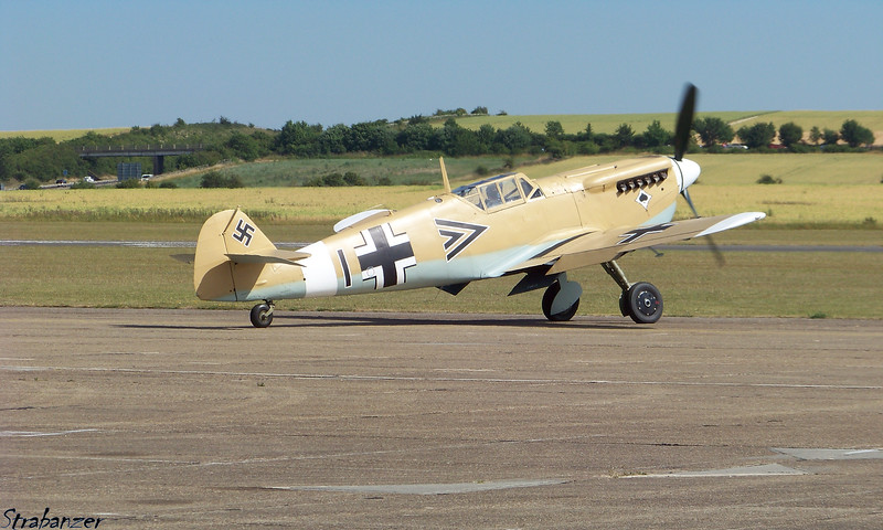 "Hispano HA-1112-M1L Buchon (RR Merlin Bf109)<br /> G-AWHE<br /> Painted in the Luftwaffe, North African scheme of a Bf109F-4/trop<br />  used by Jagdgeschwader 53, the famous ""Pik-As"" <br /> (Ace of Spades) unit flown by Major Eric Gerlitz, <br /> Gruppenkommandeur III/JG53 at Quotaifiya, Egypt in July 1942.<br /> <br /> Duxford, UK, 07/10/2015<br /> This work is licensed under a Creative Commons Attribution-<br /> NonCommercial 4.0 International License"
