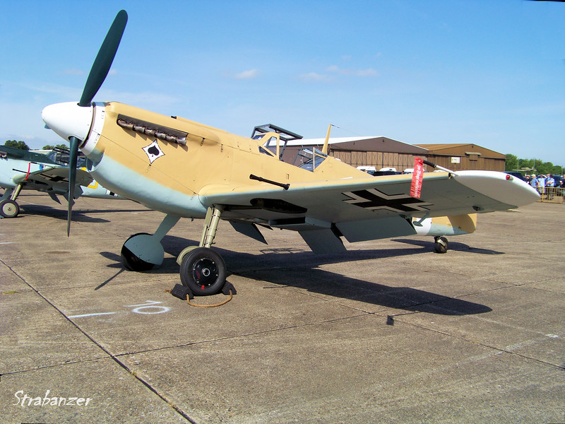 "Hispano HA-1112-M1L Buchon, C/N: 64  G-AWHE<br /> Luftwaffe, North African colorscheme painted on<br /> Bf109F-4/trop.   Jagdgeschwader 53, ""Pik-As"" (Ace of Spades) <br /> piloted by Maj Eric Gerlitz, Gruppenkommandeur III/JG53 <br /> at Quotaifiya, Egypt    July 1942.<br /> <br /> Duxford, UK, 07/11/2015<br /> This work is licensed under a Creative Commons Attribution-<br /> NonCommercial 4.0 International License"