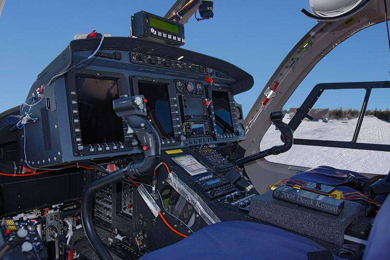 Flightdeck of a Bell 429 - an experimental helicopter (at the time of this photo Feb 6th, 2008). Snuck a quick shot while the crew was inside paying for their fuel.<br /> <br /> Sporting a decal indicating that this aircraft was operating without a certificate of airwirthiness. She was on her way to Thompson MB for cold temperature flight testing.
